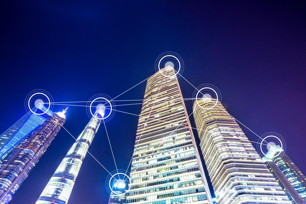 6 Hochhäuser stehen nebeneinander und sind durch Striche vernetzt